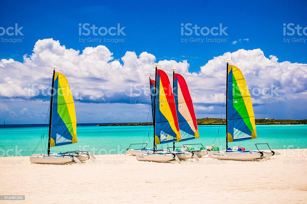 Beach with nautical vessels stock photo