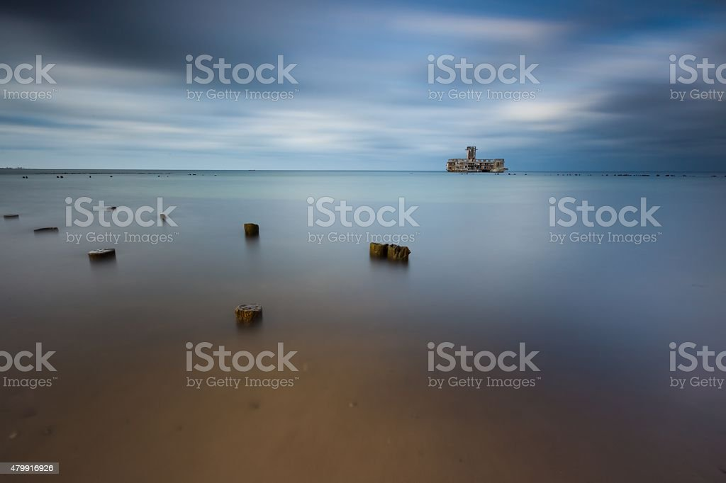 Beach with old military buildings stock photo