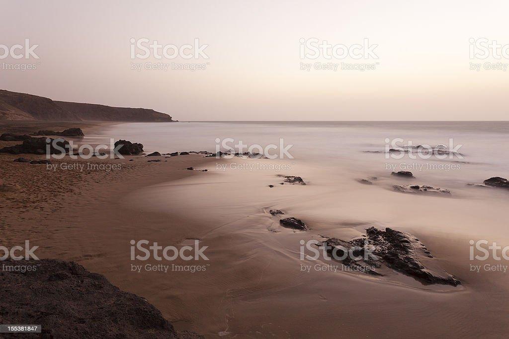 Beach With Rocks Long Exposure stock photo