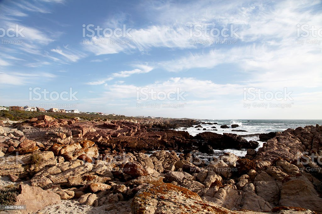 Beach with rocks, ocean in the background stock photo