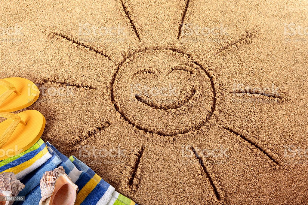 Beach with smiling sun royalty-free stock photo