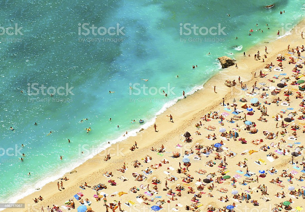 beach with tourists, sunbeds and umbrellas. holidays background stock photo