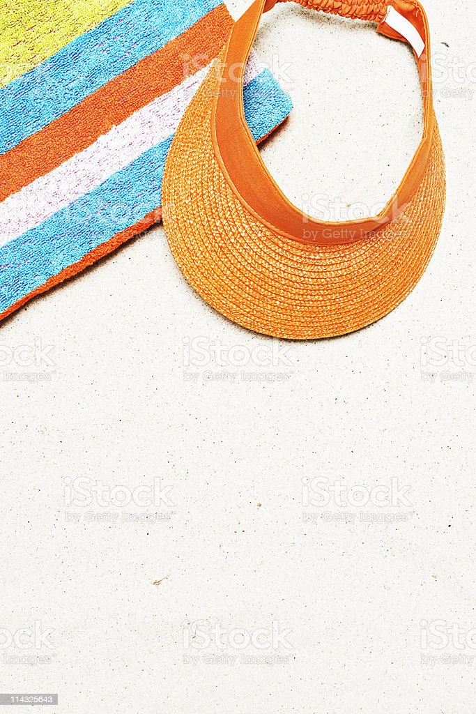 Beach with towel, cap and copy space royalty-free stock photo