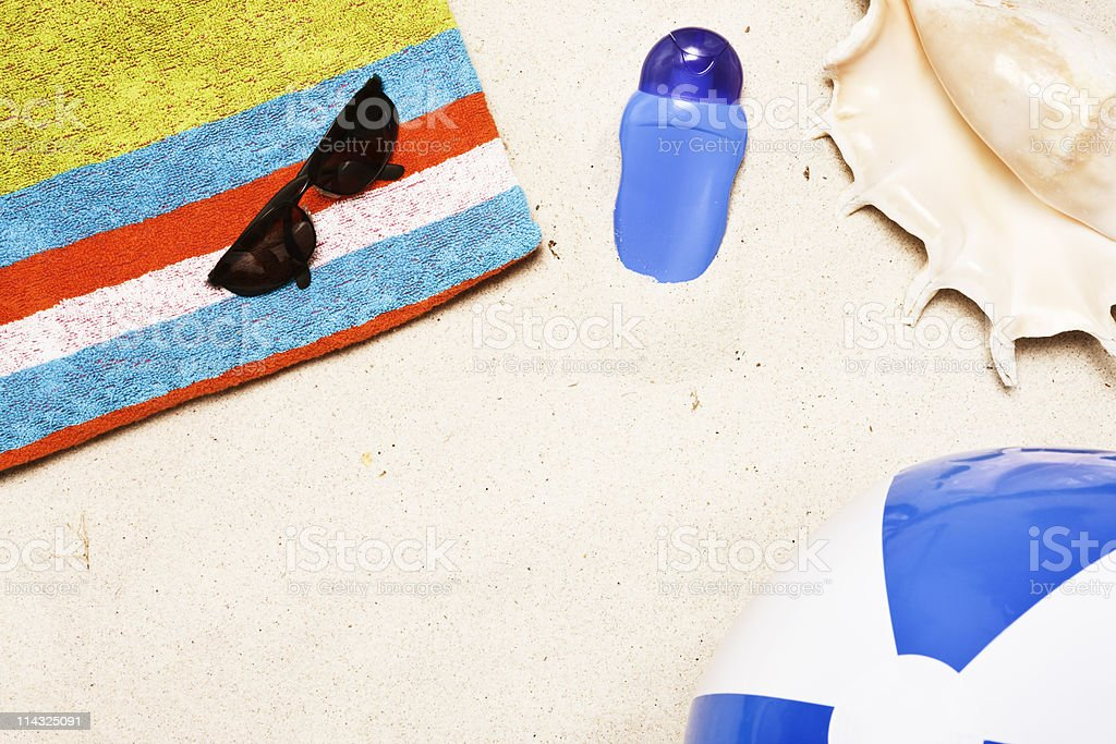 Beach with towel, shades, sun screen, shell, ball_and copy space royalty-free stock photo