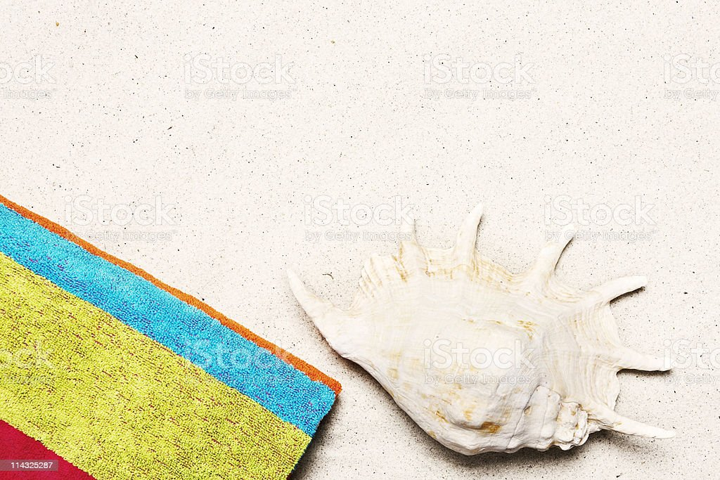 Beach with towel, shell  and copy space stock photo