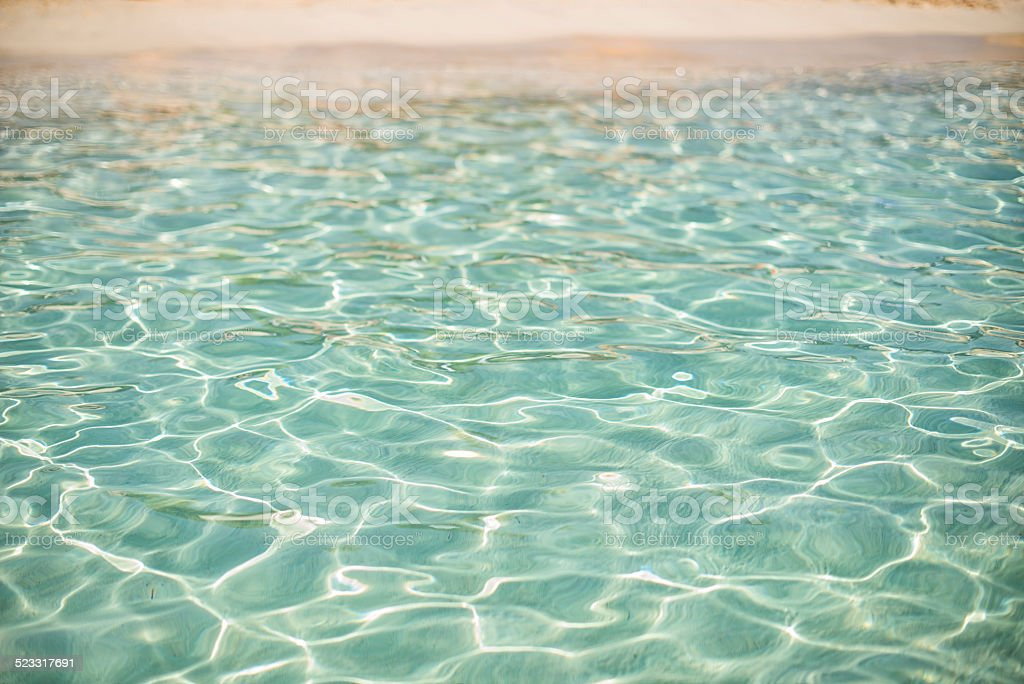 beach with turquoise water background stock photo