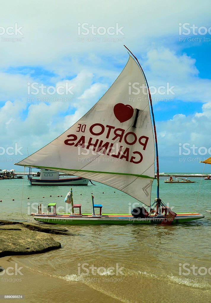 Beach with typical sail boats of northeast Brazil stock photo