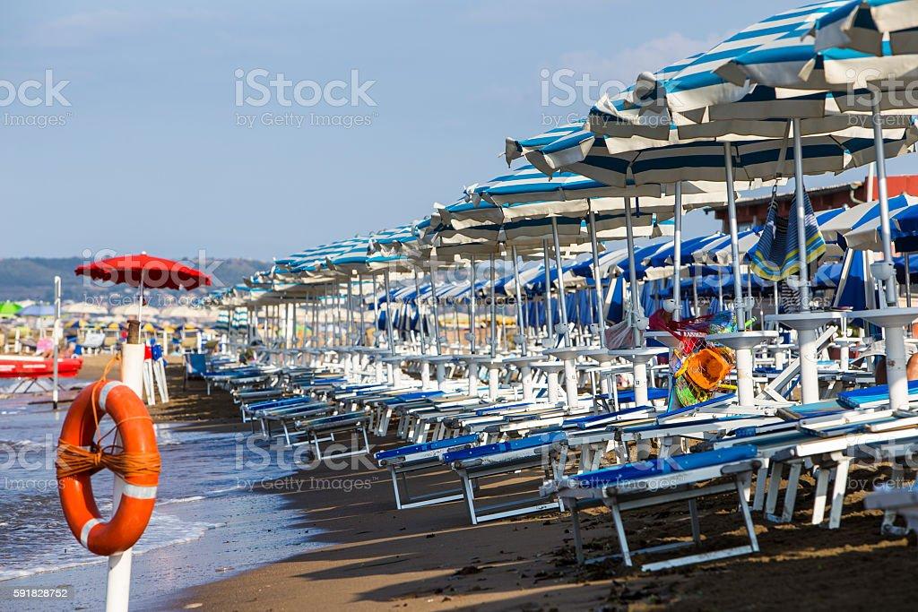 Beach with umbrellas in Italy stock photo