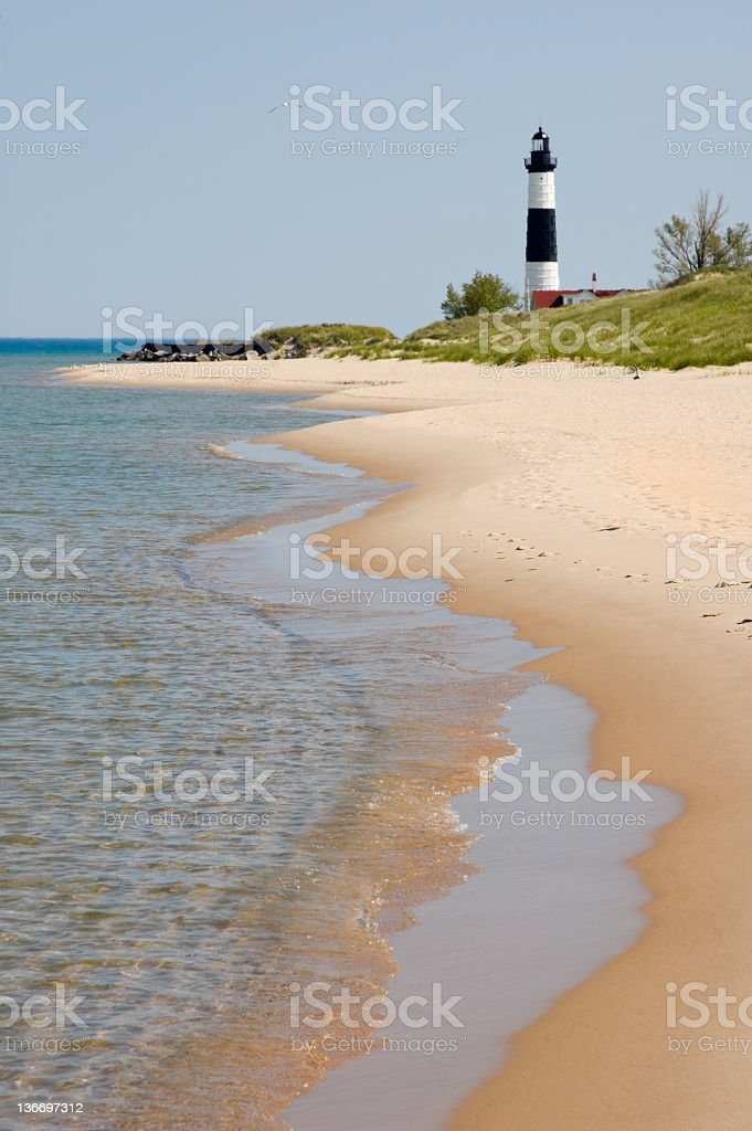 Beach with Waves and Lighthouse, Michigan Great Lakes Scenery royalty-free stock photo