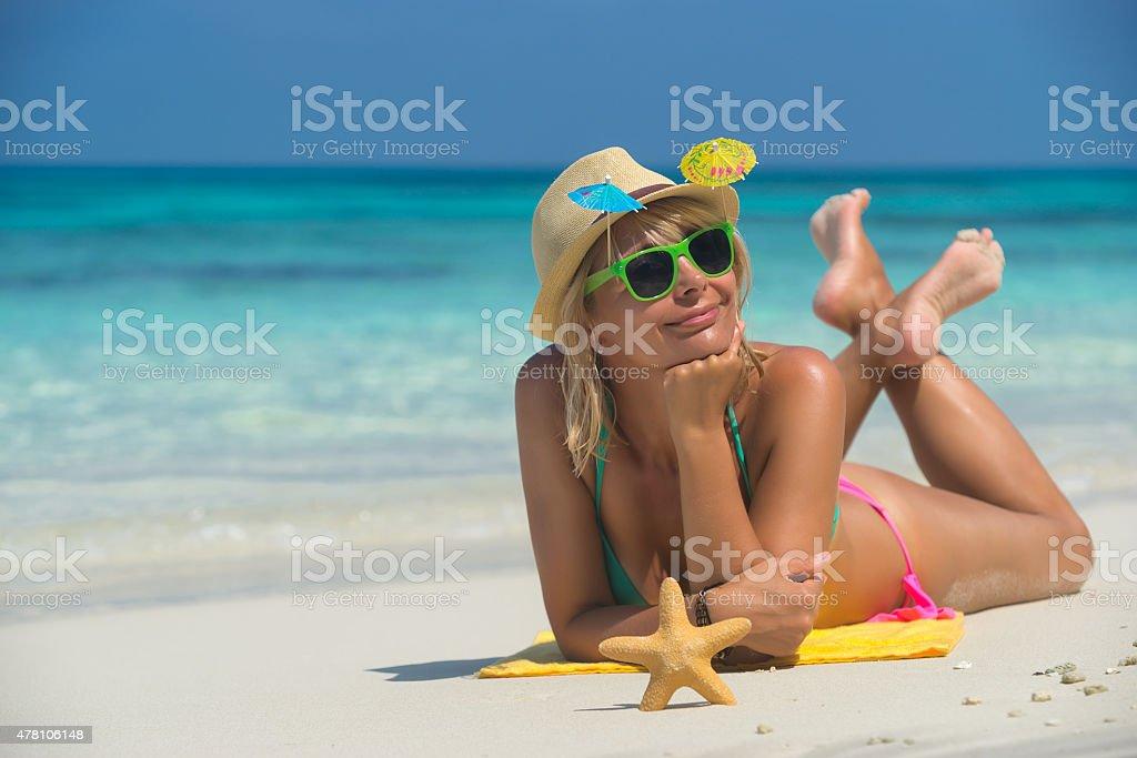 Beach woman laughing having fun stock photo