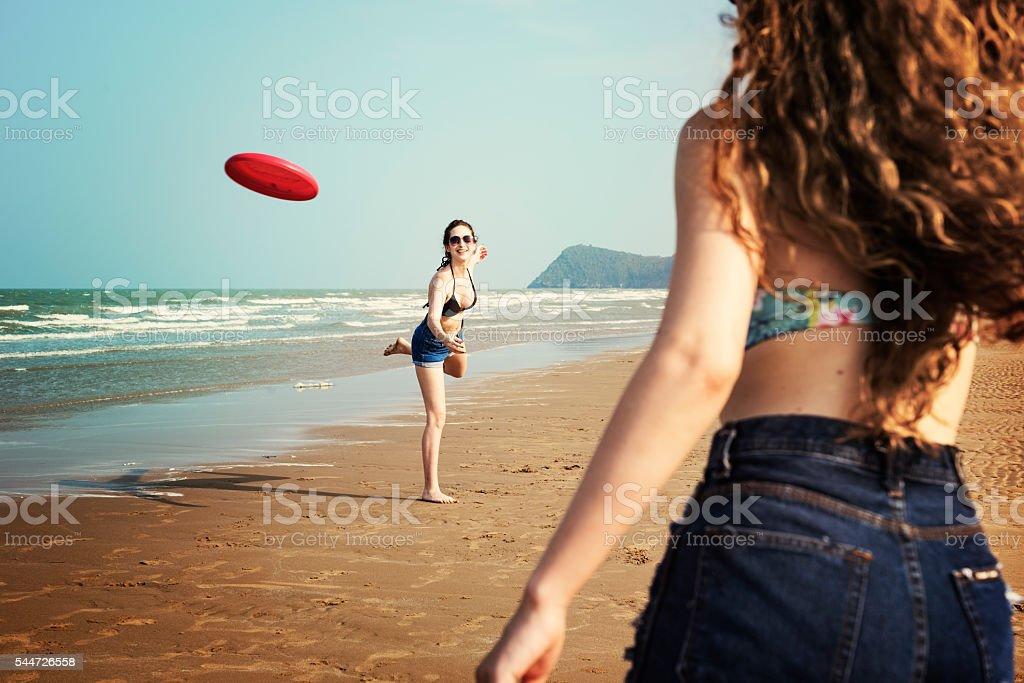 Beach Women Summer Playful Friends Concept stock photo