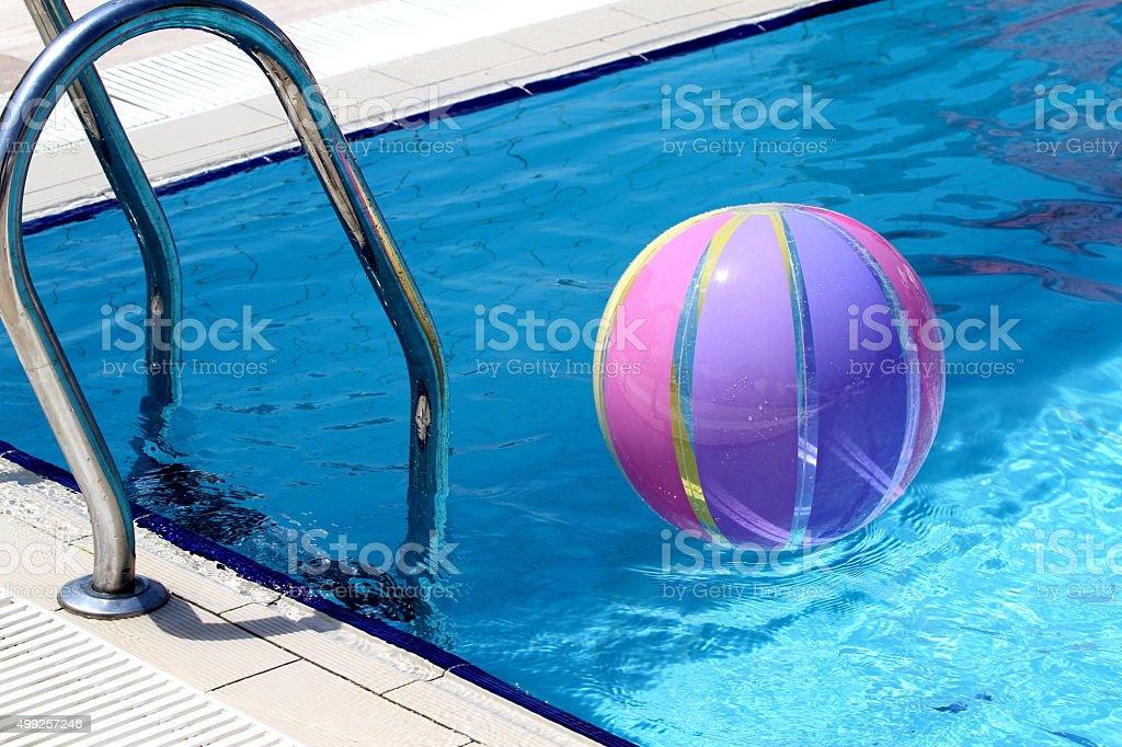 Beachball and swimmingpool stock photo