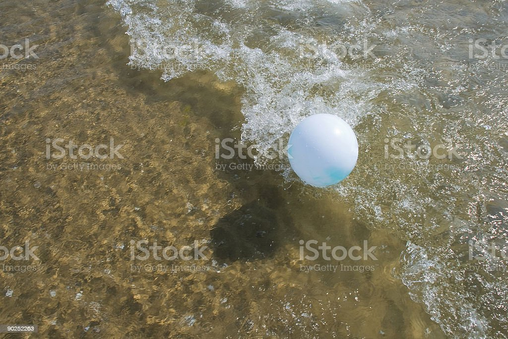 Beachball on Waves royalty-free stock photo