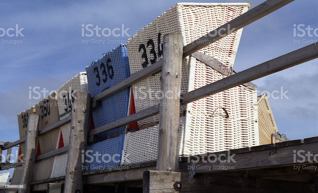 beach-chairs on a wooden platform 3 royalty-free stock photo