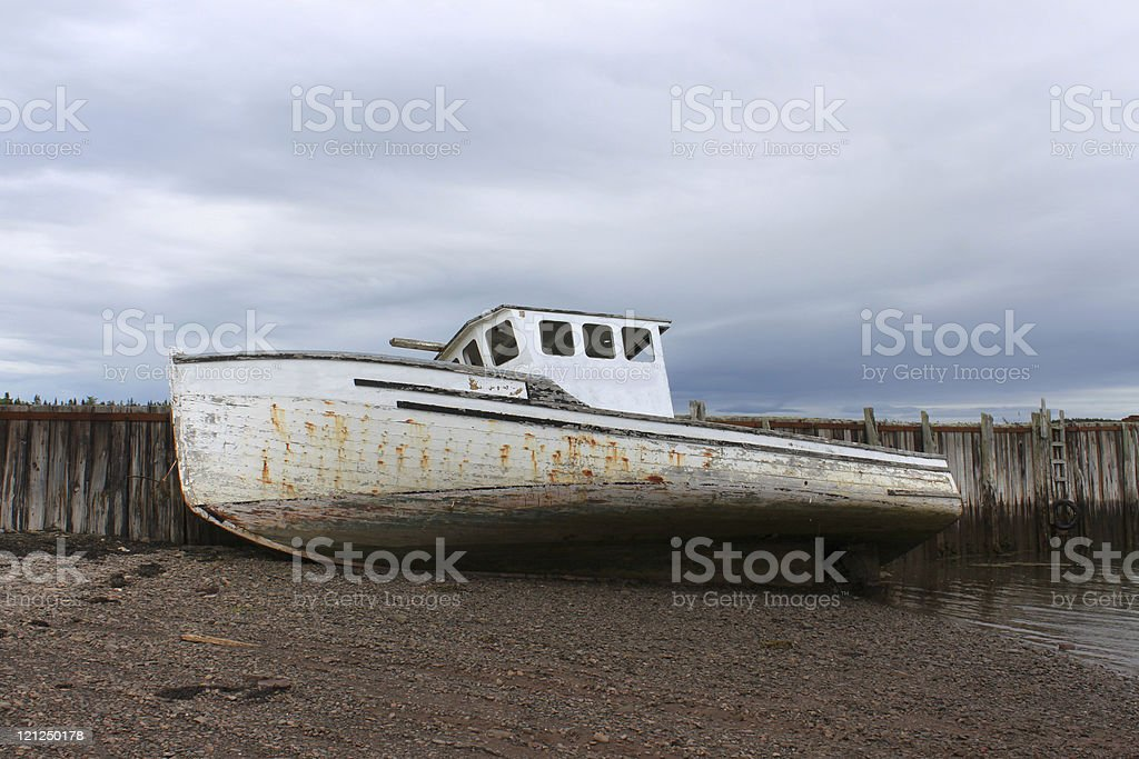 Beached boat in New Brunswick, Canada royalty-free stock photo