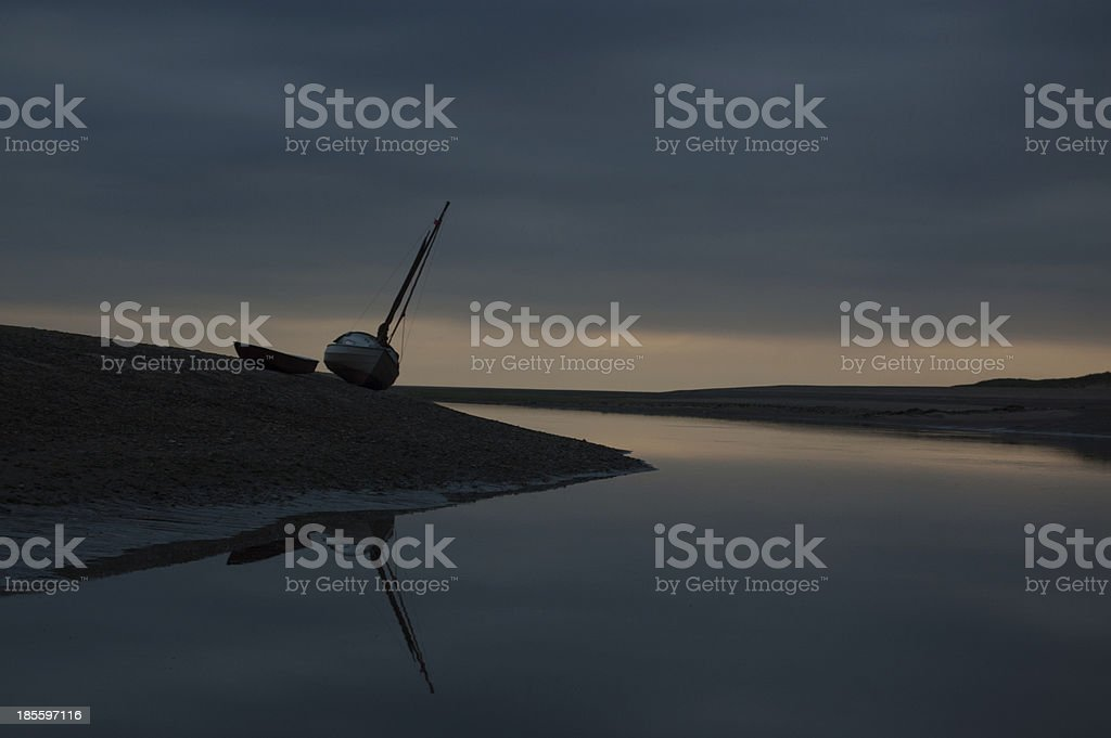 Beached boat on Norfolk Coast royalty-free stock photo