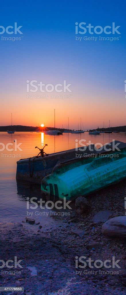 Beached boats with sunset royalty-free stock photo