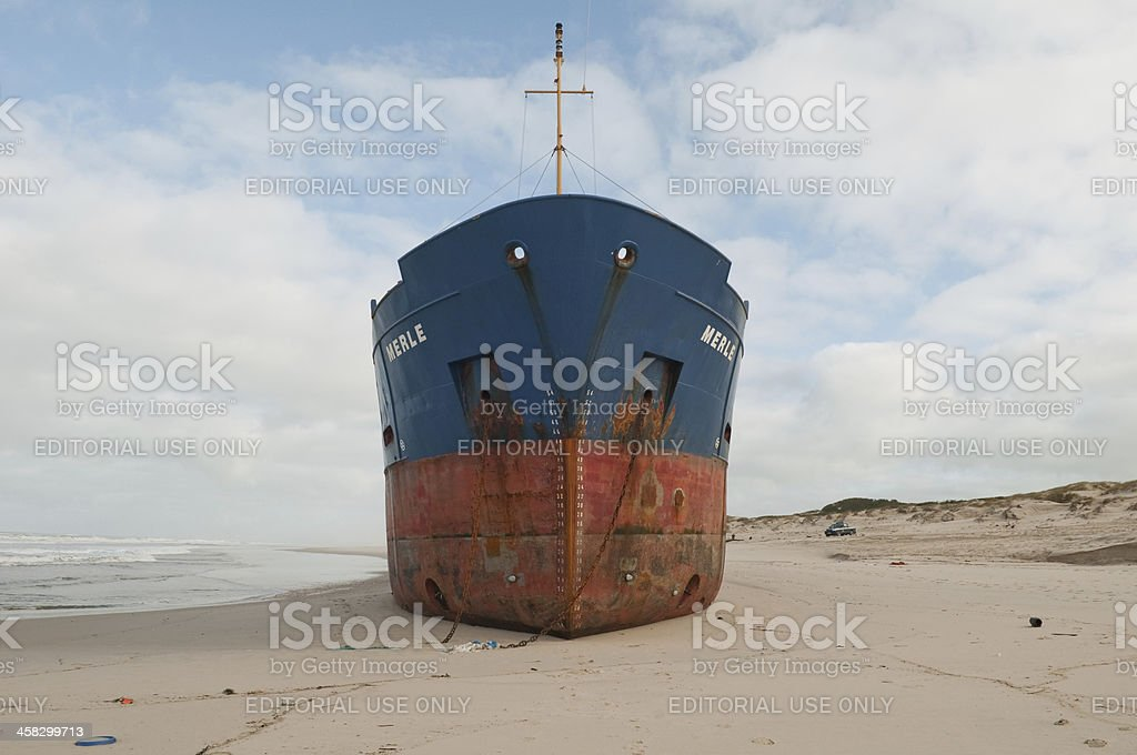 beached cargo ship stock photo