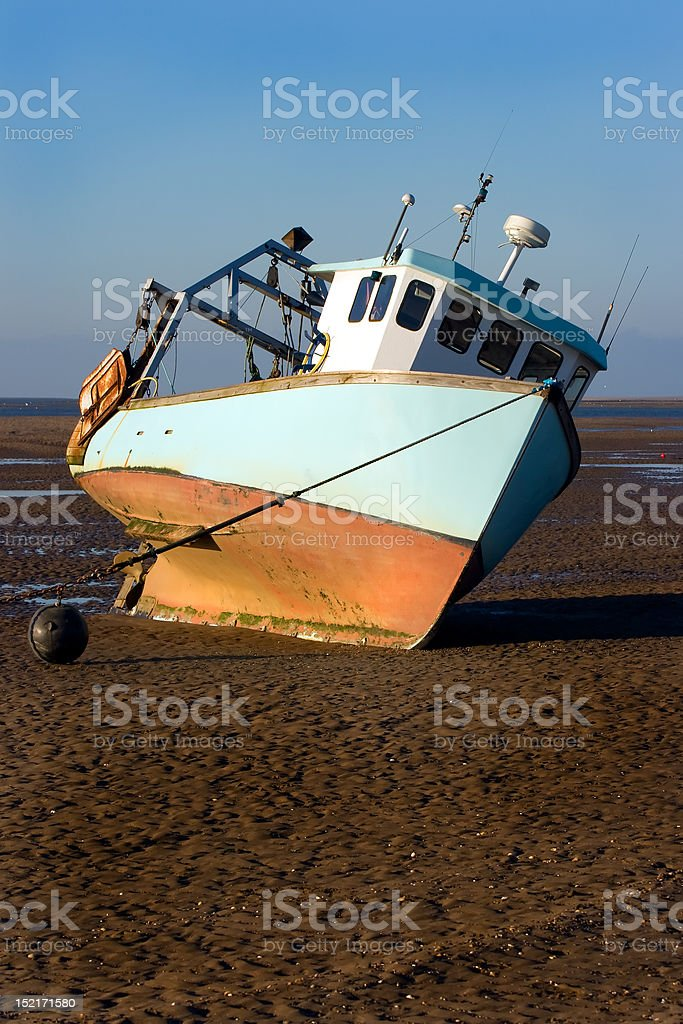 Beached fishing boat royalty-free stock photo