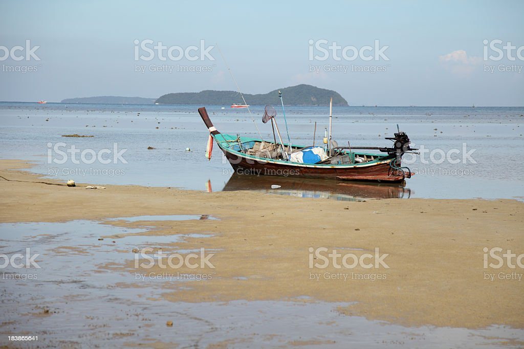 Beached fishing boat stock photo