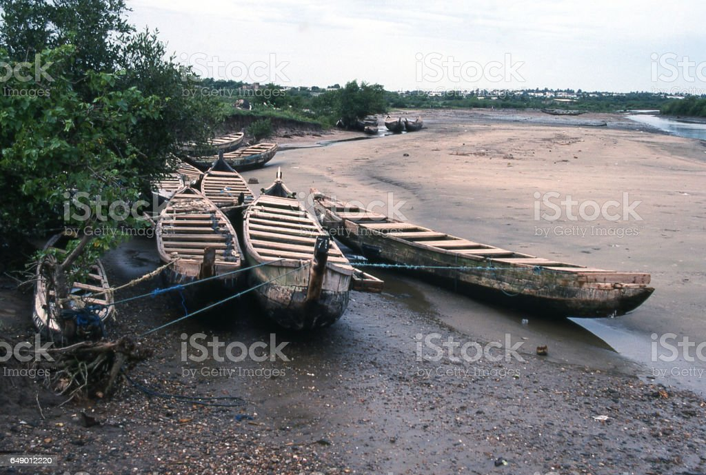 Beached fishing canoes at coastal village near Accra Africa stock photo