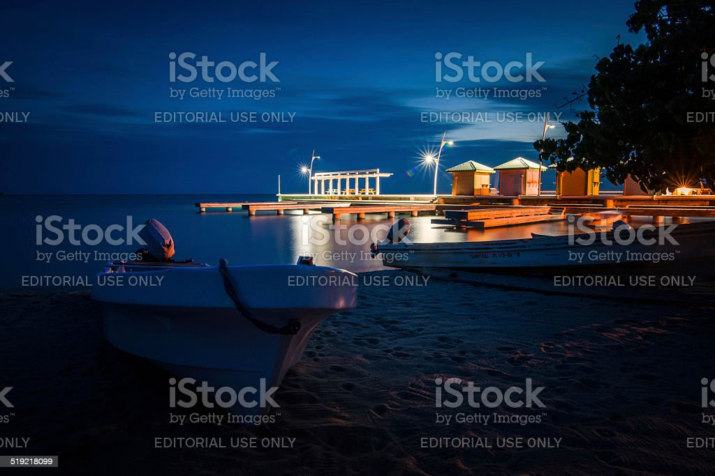 Beached rowing boats on the sand at night stock photo