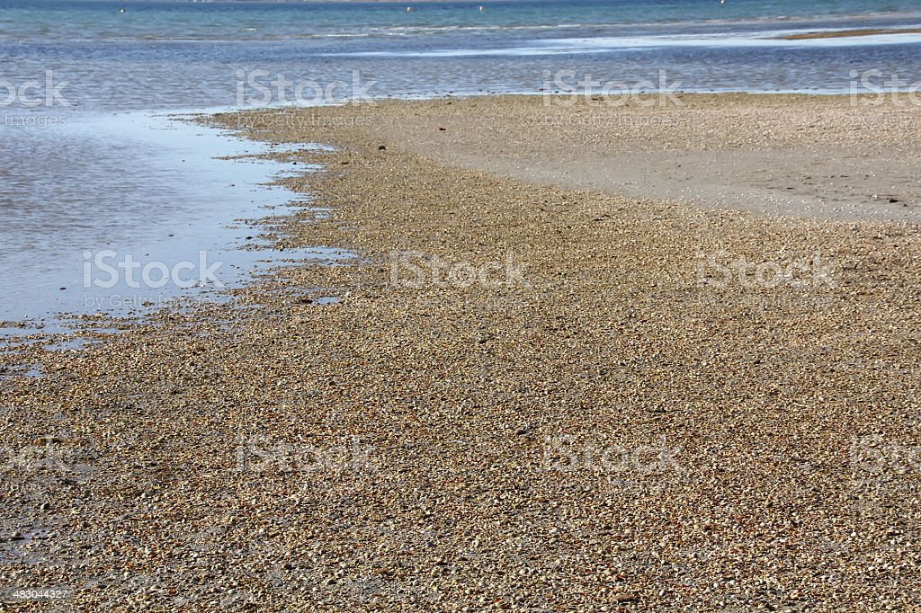 Beaches formed by thousands of small shells stock photo