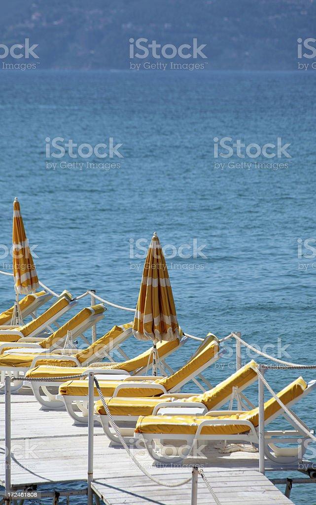Beachfront with beachchairs royalty-free stock photo