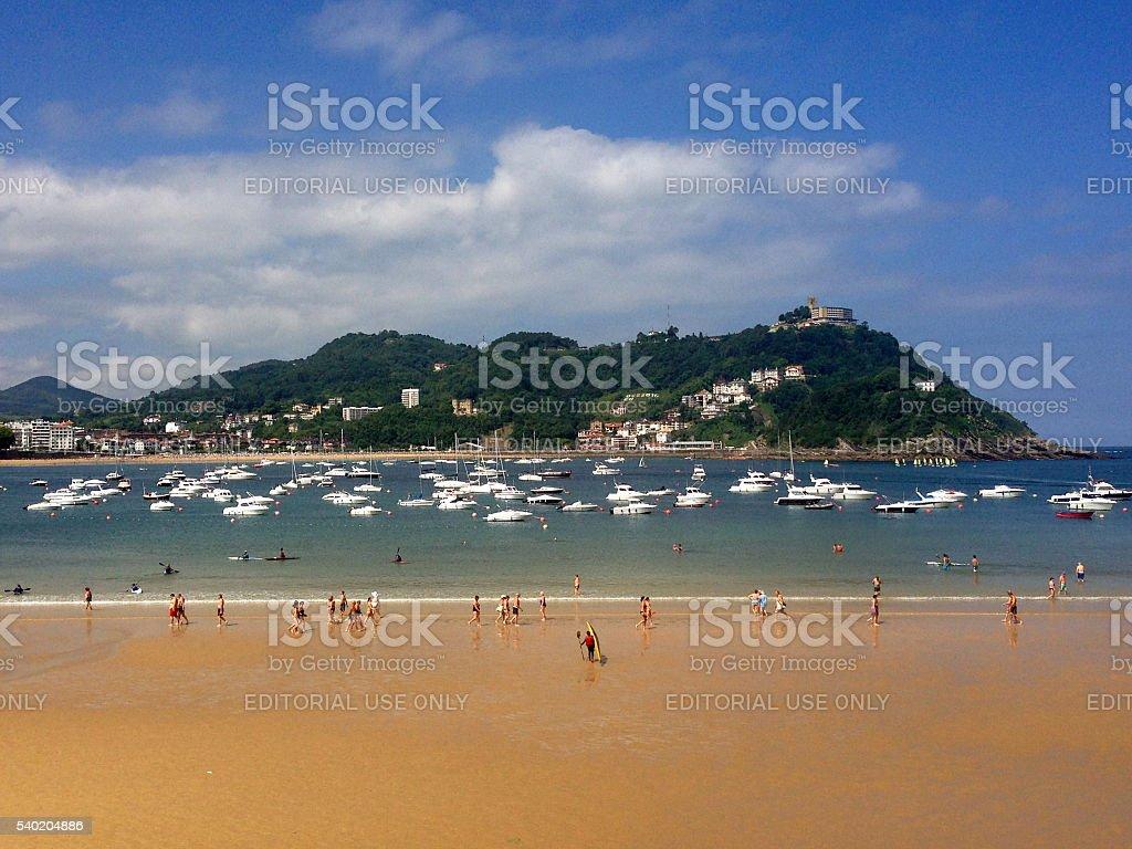 Beachgoers and sailboats on Concha Bay in San Sebastián, Spain stock photo