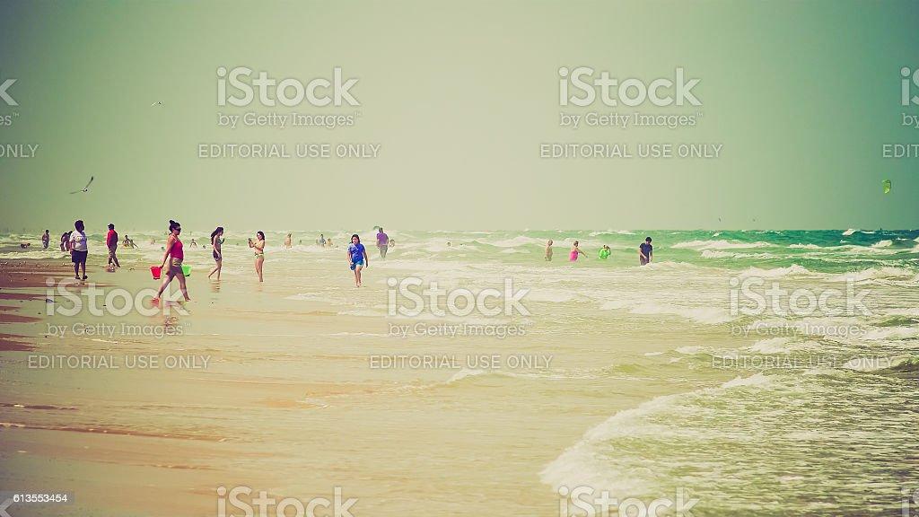 Beachgoers Enjoying the Beach on South Padre Island, Texas stock photo