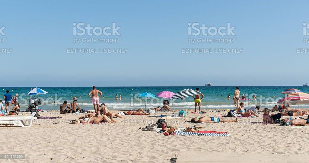 Beach-goers enjoyng hot summer day at Postiguet Beach, Alicante stock photo