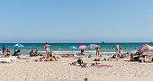 Beach-goers enjoyng hot summer day at Postiguet Beach, Alicante