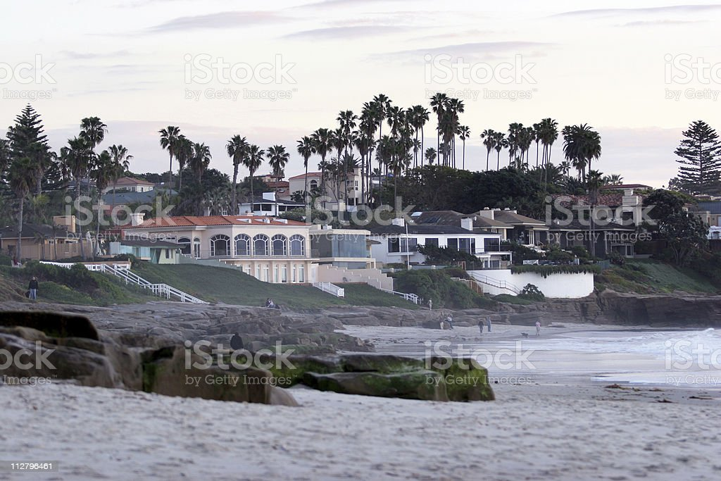 beachside beachfront houses with palm trees surf and sand California royalty-free stock photo