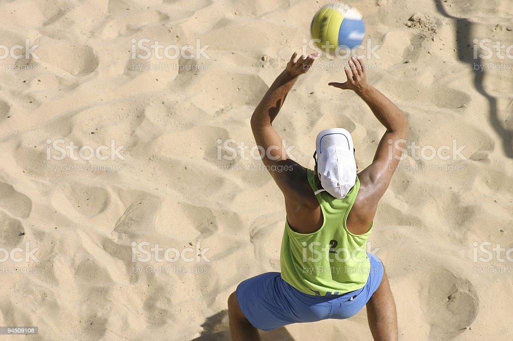 Beachvolley playing the ball royalty-free stock photo