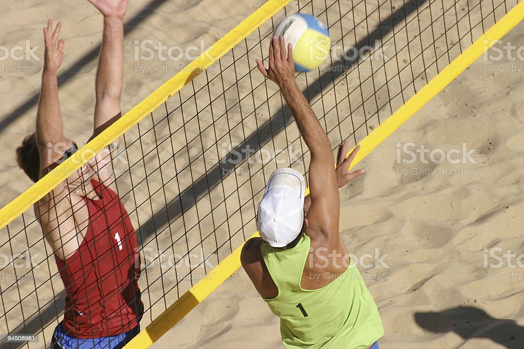 Beachvolley two players duel at the net stock photo