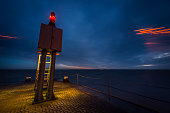 Beacon and jetty at sunset