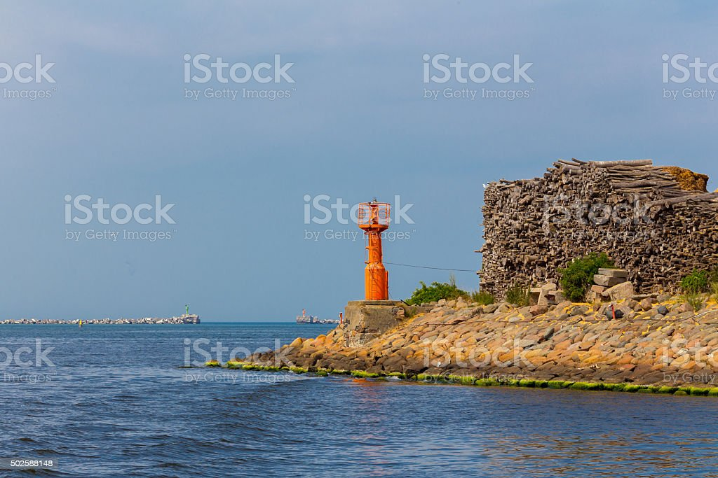 Beacon at the harbor channel stock photo