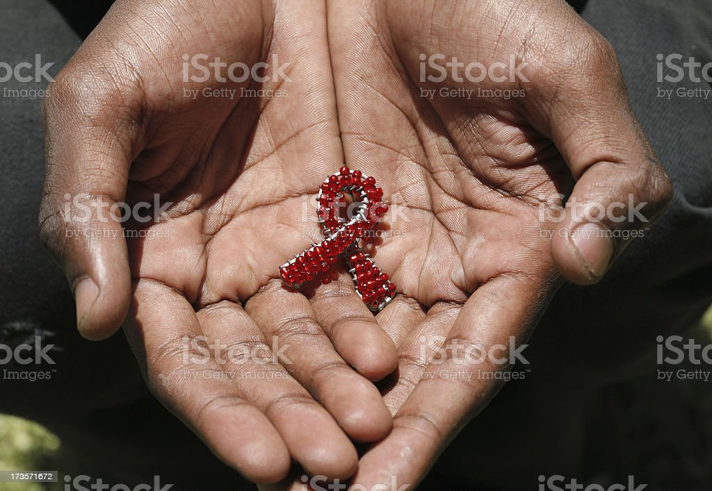 Beaded AIDS in hands stock photo