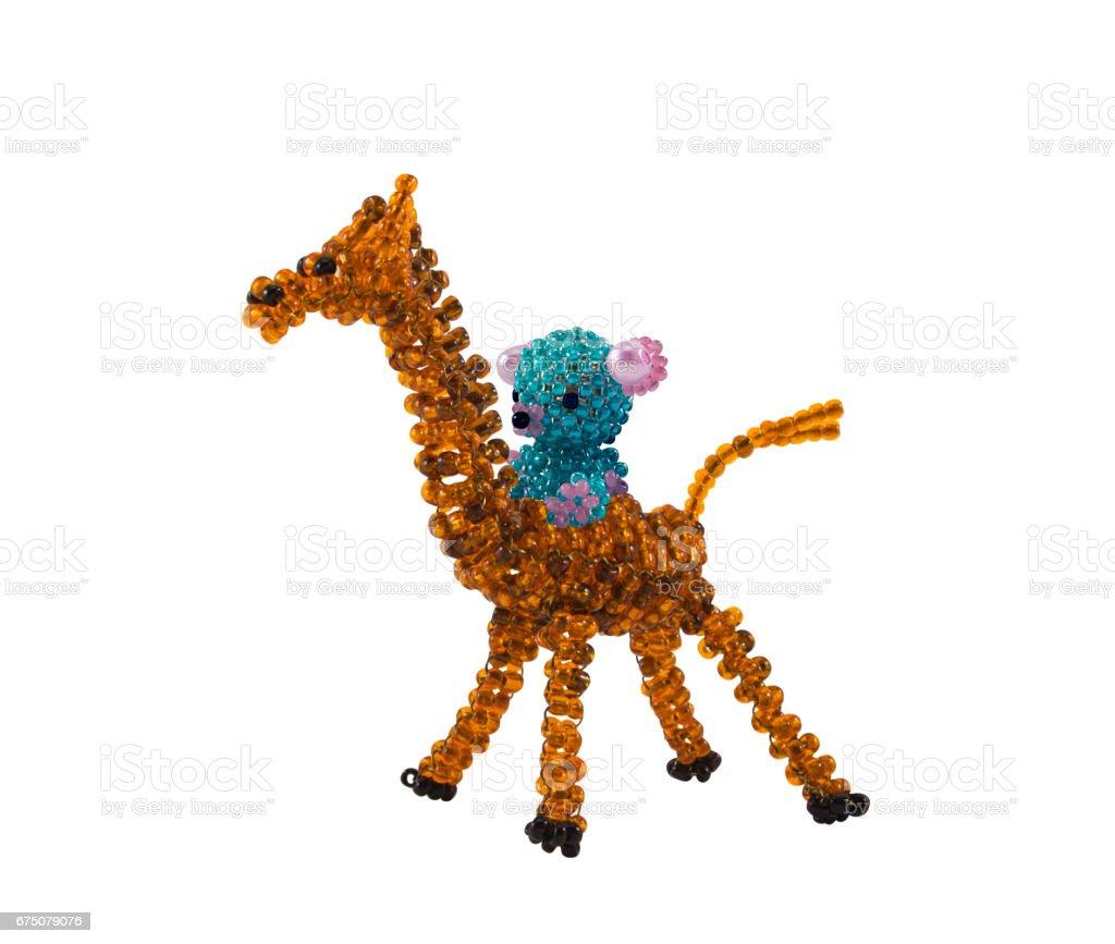 Beaded giraffe with beaded bear on stock photo