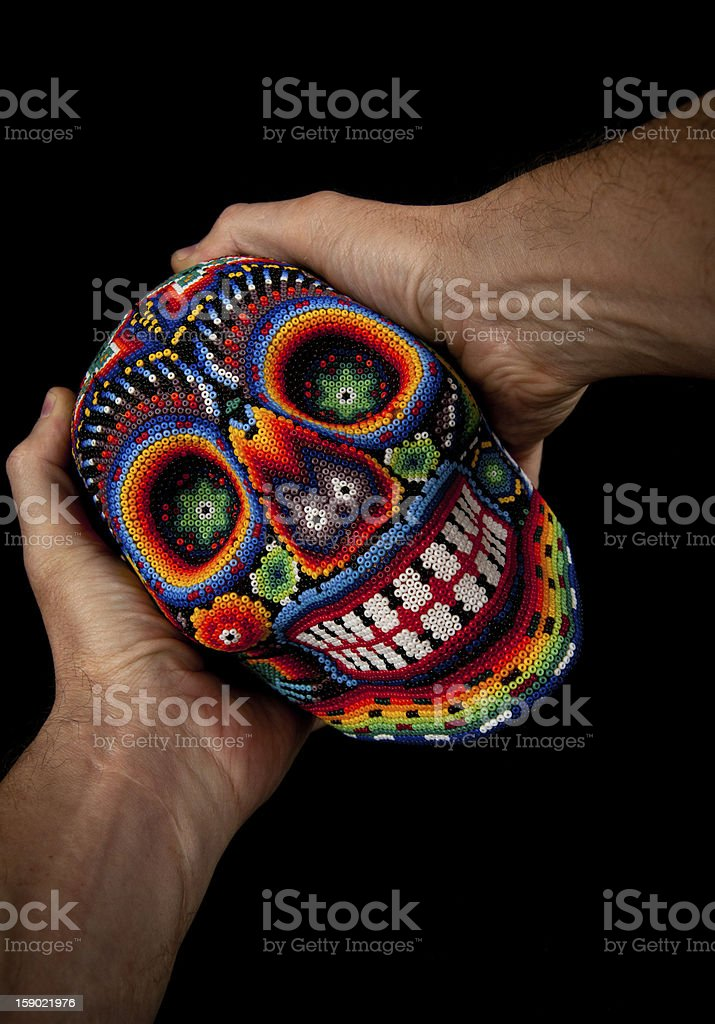 Beaded Skull with hands (Surprised) stock photo