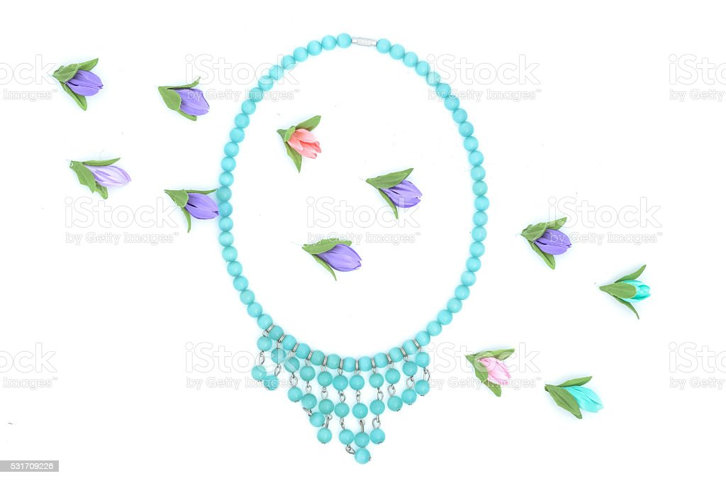 beads and flowers on white stock photo
