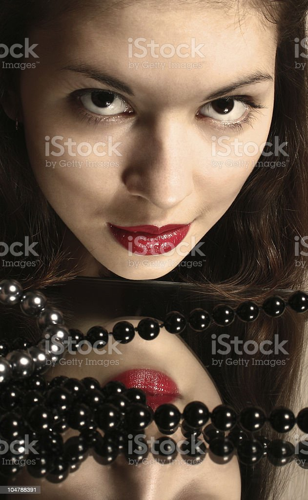 Beads and red lips. royalty-free stock photo
