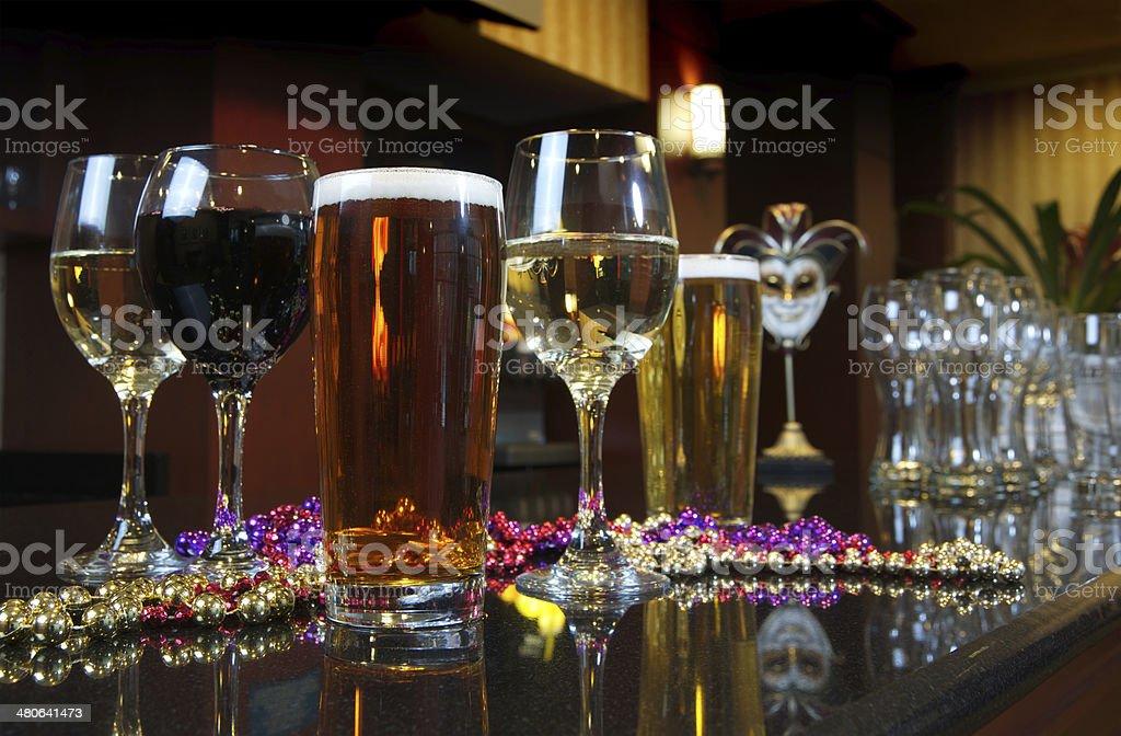 Beads, Bear, and Wine Reflecting onto Granite Countertop stock photo