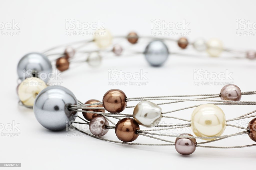 Beads of many colors, shapes and sizes strung on multi-wires royalty-free stock photo