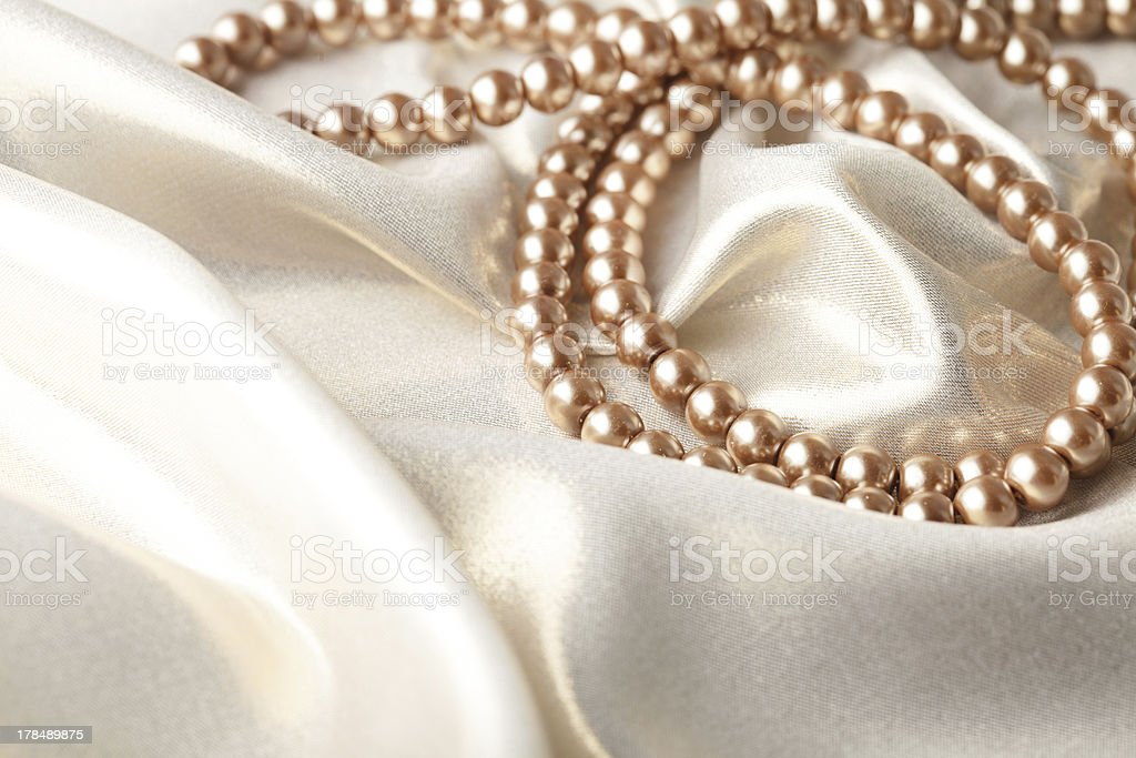beads on silk stock photo