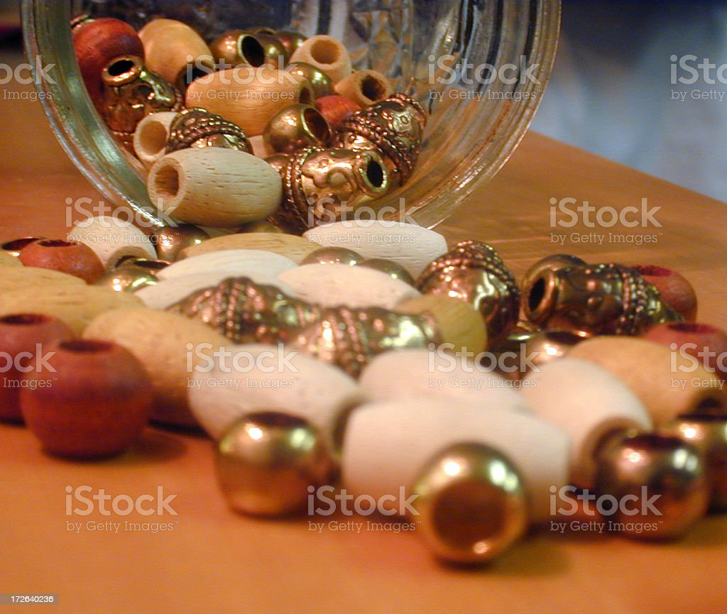 Beads spilling from container stock photo