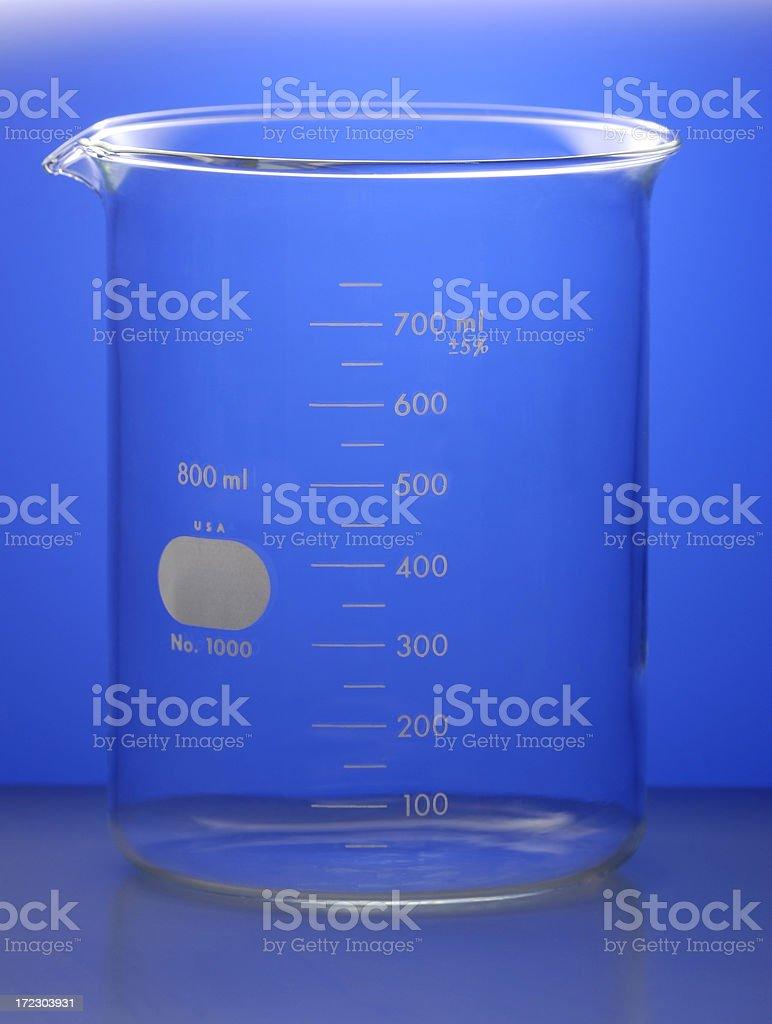Beaker on Blue Gradient Background royalty-free stock photo
