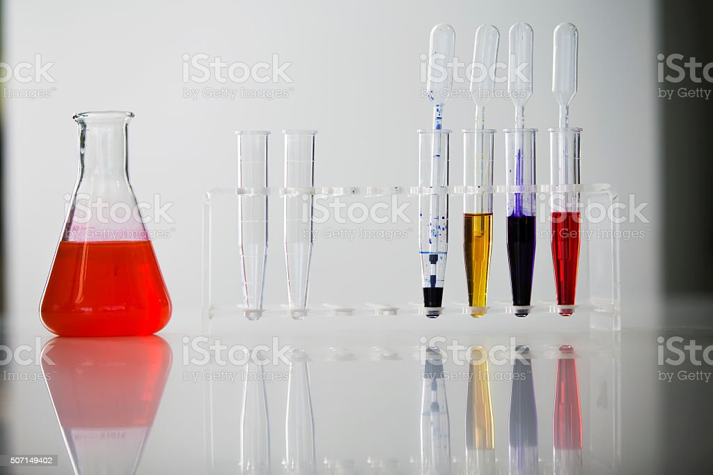 Beakers and tubes on bright Background stock photo