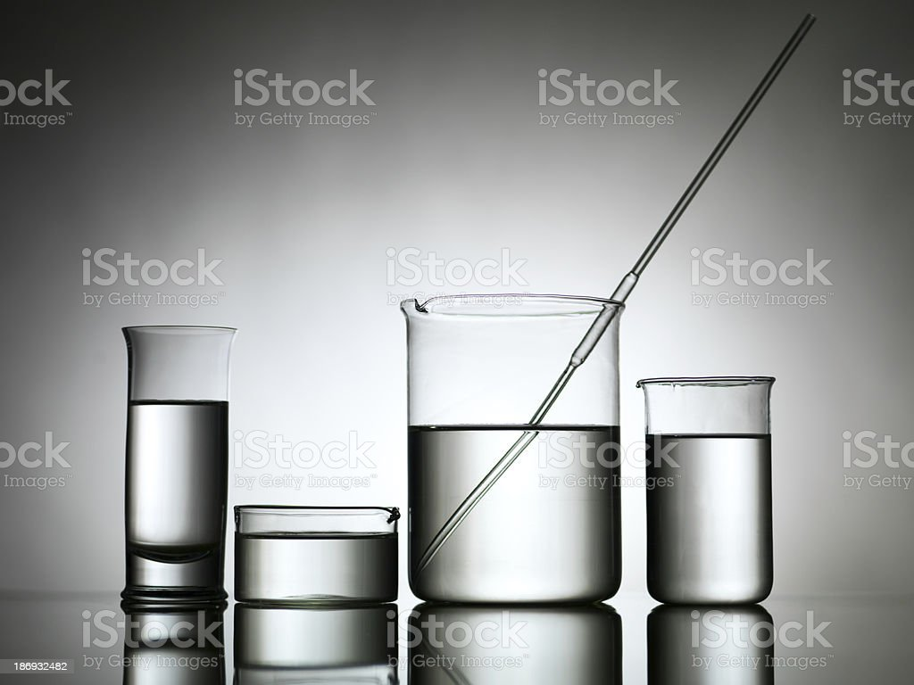 beakers with dropper and transparent liquid substance royalty-free stock photo