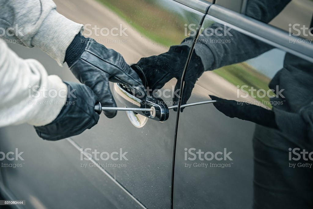 Beaking into a car stock photo